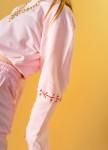 Изображение Женский костюм розовый с завязками